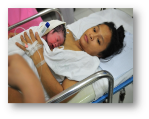 Mother and baby being transferred to their room together. Photo courtesy of the Essential Intrapartum and Newborn Care Team